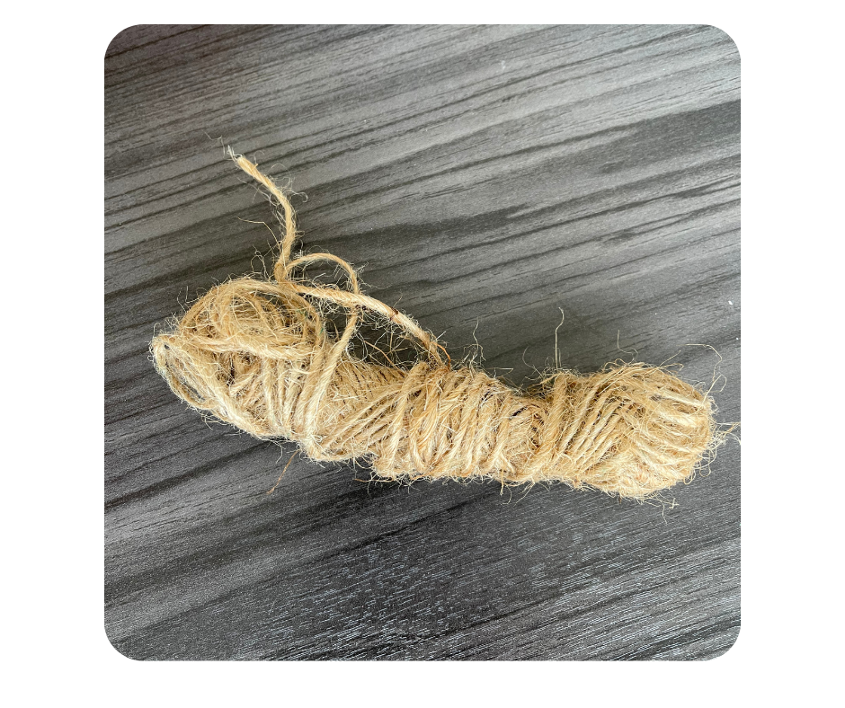 a ball of twine on a tabletop