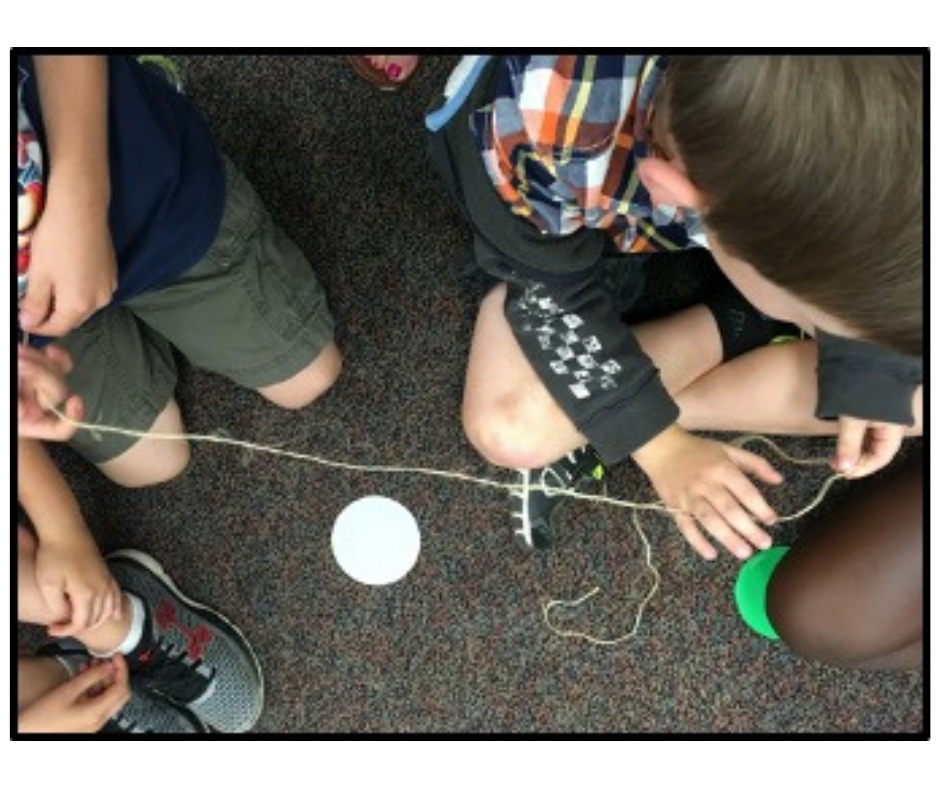 Students holding a string together
